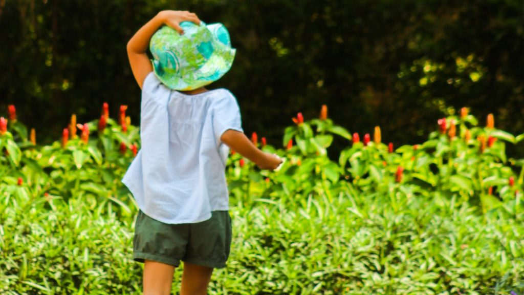 Child in green hat on a scavenger hunt